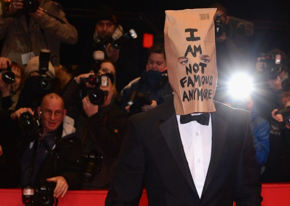 Wearing a paper bag over his face, Shia LaBeouf walks the Red Carpet in Berlin.