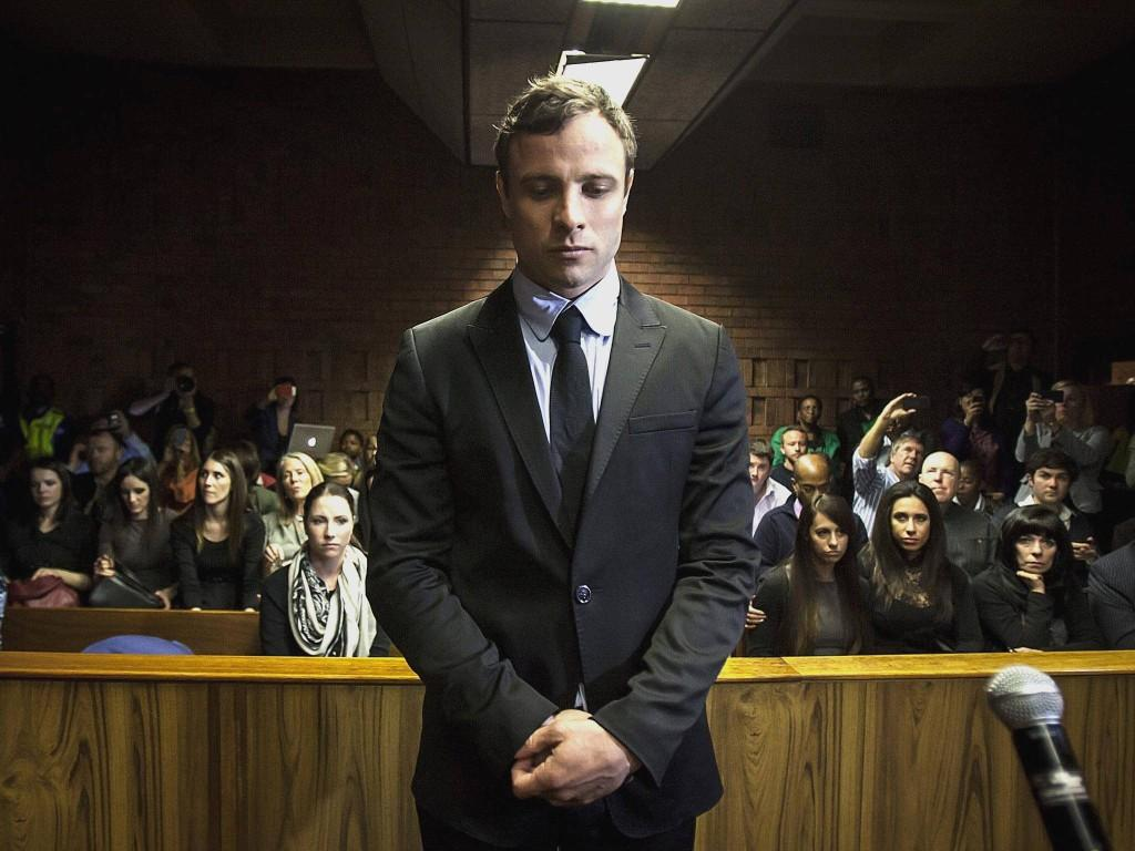 Oscar Pistorius stands in court as he is tried for premeditated murder.