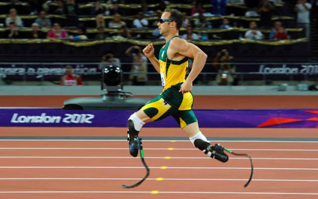 Oscar Pistorius runs in the Beijing Olympic Games. He was the first to run on his prosthetic legs in an Olympic track event.