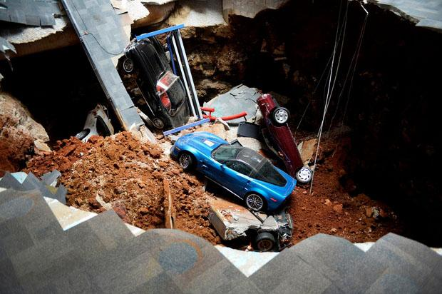 The museum tries to get all the cars out after the disastrous sinkhole incident.