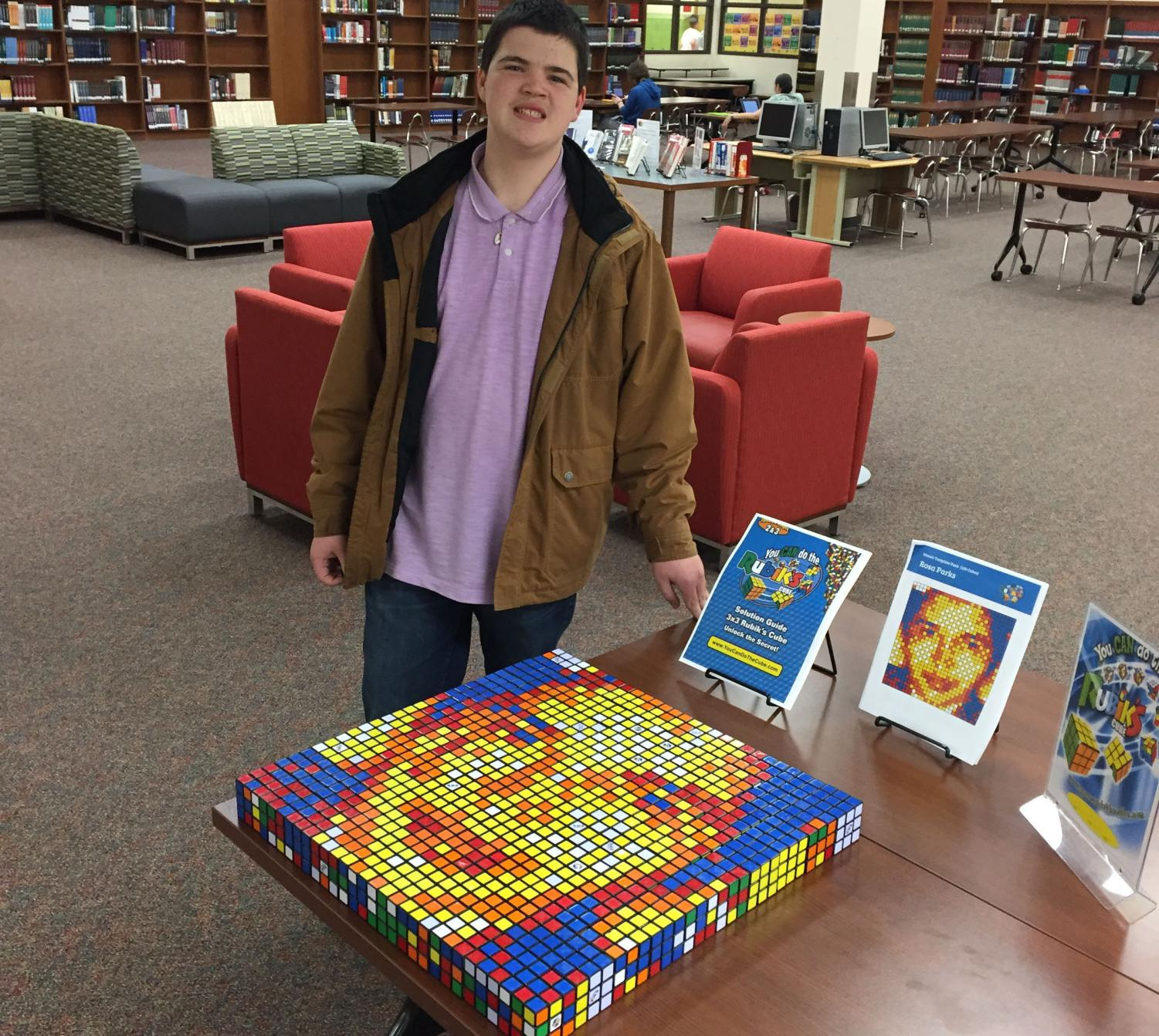 """A master at the Rubik's Cube, junior Jake Hudson finished the library's first Rubik's cube challenge. He spent approximately an hour and thirty minutes working on the project. """"I just like doing Rubik's Cubes because I like to see what people can create with them, and I just wanted to see what the experience would be like for me to create a picture."""""""