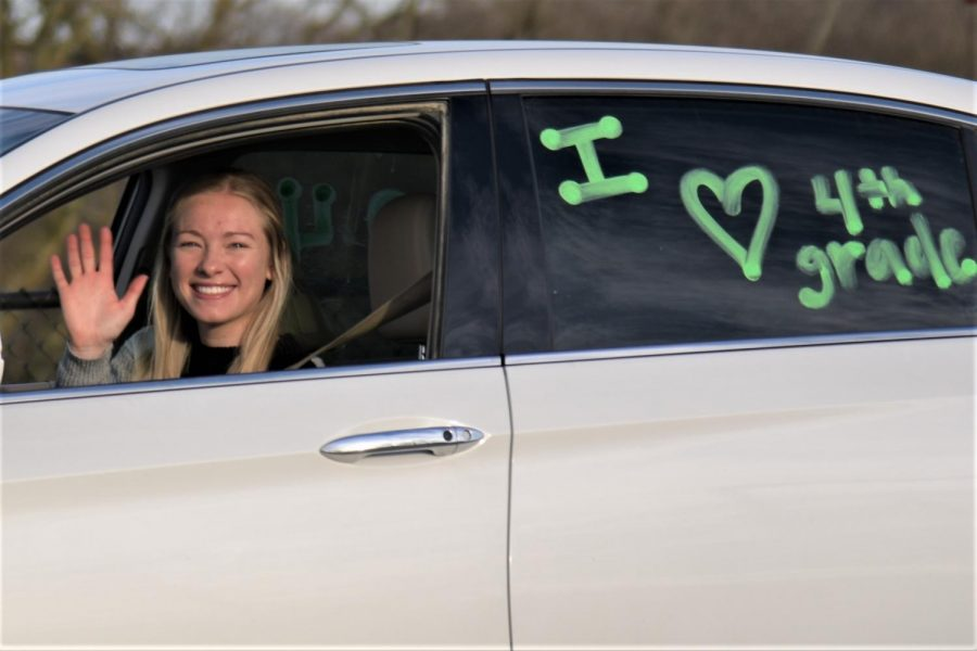Cassie+Stewart%2C+a+fourth+grade+teacher+at+Tecumseh+South%2C+decorated+her+car+with+a+message+in+anticipation++to+see+her+students+again.+