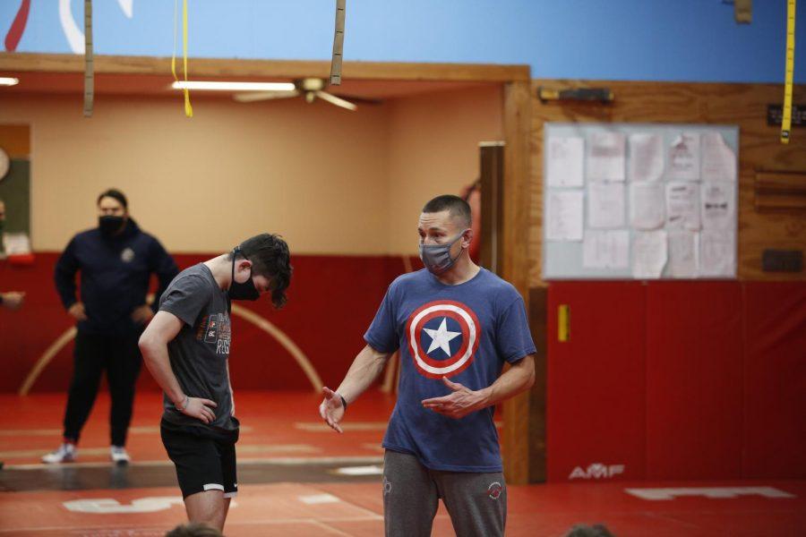 Coach Parks showing technique during practice.